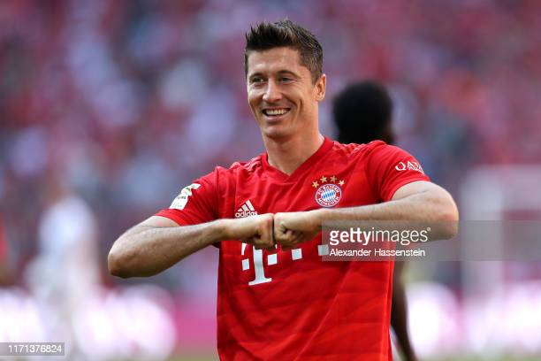 Robert Lewandowski of FC Bayern Muenchen celebrates scoring the 5th goal during the Bundesliga match between FC Bayern Muenchen and 1 FSV Mainz 05 at...