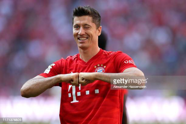 Robert Lewandowski of FC Bayern Muenchen celebrates scoring the 5th goal during the Bundesliga match between FC Bayern Muenchen and 1 FSV Mainz 05 at...