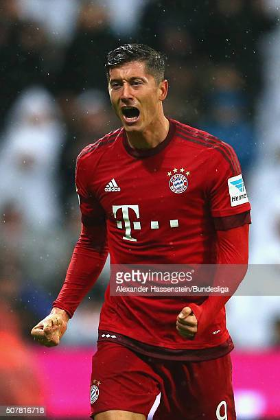 Robert Lewandowski of FC Bayern Muenchen celebrates scoring the opening goal during the Bundesliga match between FC Bayern Muenchen and 1899...