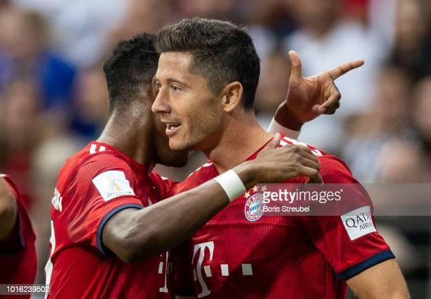 Robert Lewandowski of FC Bayern Muenchen celebrates with David Alaba of FC Bayern Muenchen after scoring his team's first goal during the DFL...
