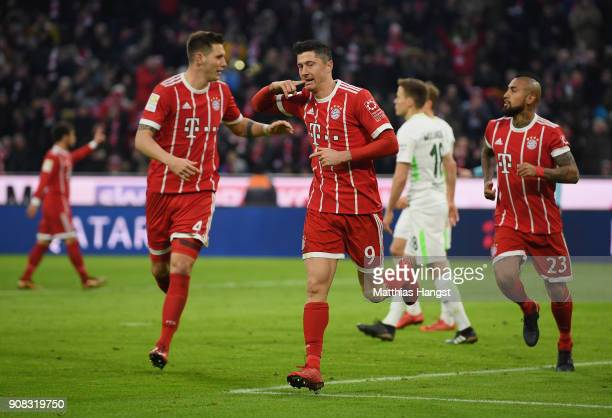 Robert Lewandowksi of FC Bayern Muenchen celebrates with his teammates after scoring his team's second goal during the Bundesliga match between FC...
