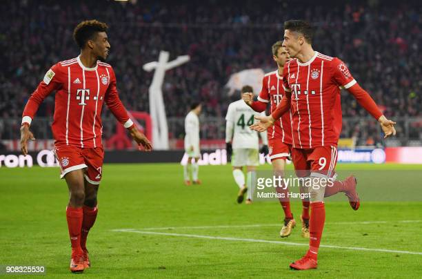 Robert Lewandowksi of FC Bayern Muenchen celebrates with his teammates after scoring his team's third goal during the Bundesliga match between FC...