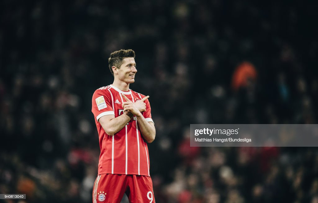 Robert Lewandowksi of FC Bayern Muenchen celebrates with his team-mates after scoring his team's sixth goal during the Bundesliga match between FC Bayern Muenchen and Borussia Dortmund at Allianz Arena on April 1, 2018 in Munich, Germany.