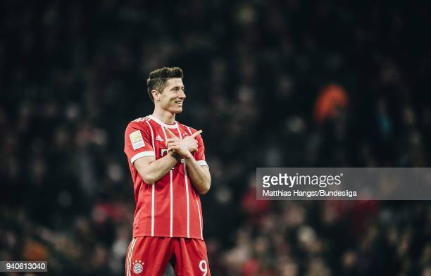 Robert Lewandowksi of FC Bayern Muenchen celebrates with his teammates after scoring his team's sixth goal during the Bundesliga match between FC...