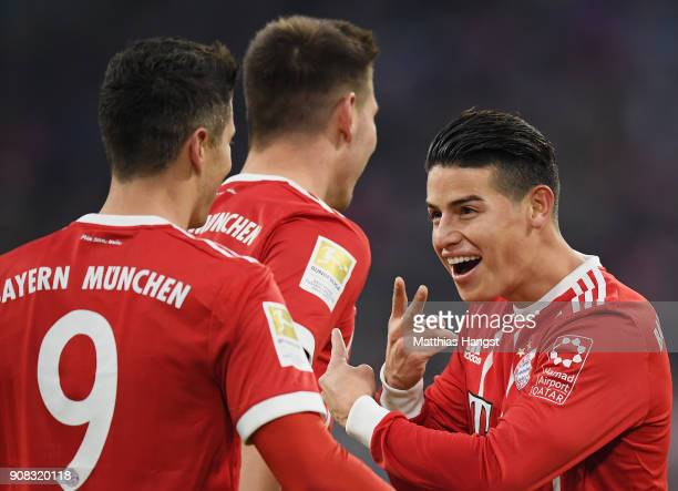 Robert Lewandowksi of FC Bayern Muenchen celebrates with his teammate James Rodriguez of FC Bayern Muenchen after scoring his team's second goal...