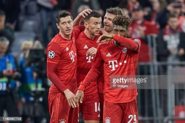 Robert Lewandowski of FC Bayern Muenchen celebrates with Ivan Perisic of FC Bayern Muenchen, Thomas Mueller of FC Bayern Muenchen and Kingsley Coman...