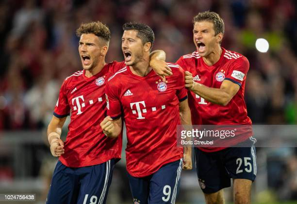Robert Lewandowski of FC Bayern Muenchen celebrates with team mates after scoring his team's second goal by penalty during the Bundesliga match...