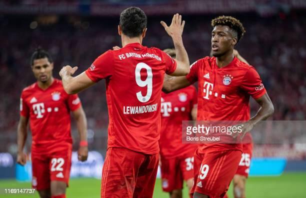 Robert Lewandowski of FC Bayern Muenchen celebrates with team mates after scoring his team's first goal during the Bundesliga match between FC Bayern...