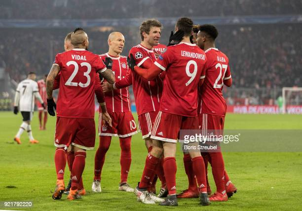 Robert Lewandowski of FC Bayern Muenchen celebrates with team mates after scoring his team's fourth goal during the UEFA Champions League Round of 16...