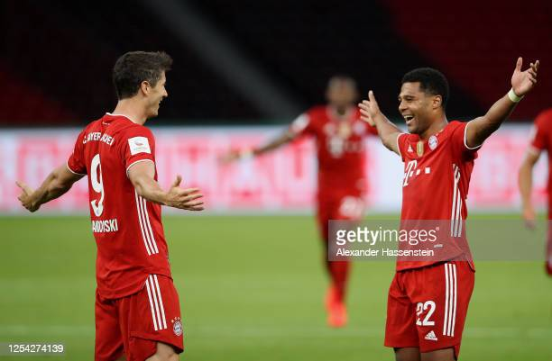 Robert Lewandowski of FC Bayern Muenchen celebrates with teammate Serge Gnabry of FC Bayern Muenchen after scoring his team's third goal during the...