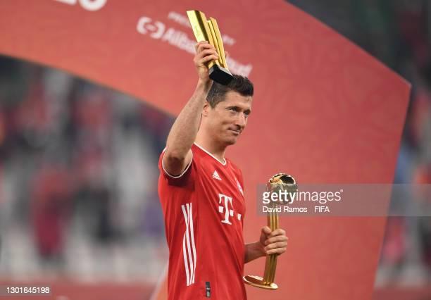 Robert Lewandowski of FC Bayern Muenchen celebrates with the Alibaba Cloud Award and the FIFA Club World Cup Qatar 2020 adidas golden ball trophy...