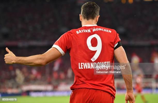 Robert Lewandowski of FC Bayern Muenchen gestures during the Bundesliga match between FC Bayern Muenchen and Bayer 04 Leverkusen at Allianz Arena on...