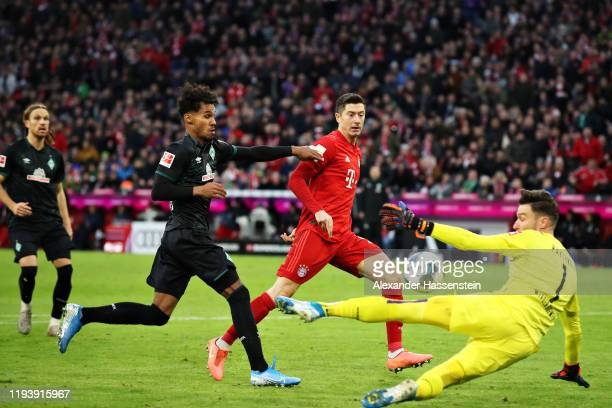 Robert Lewandowski of FC Bayern Muenchen has a shot saved by Jiri Pavlenka of SV Werder Bremen during the Bundesliga match between FC Bayern Muenchen...