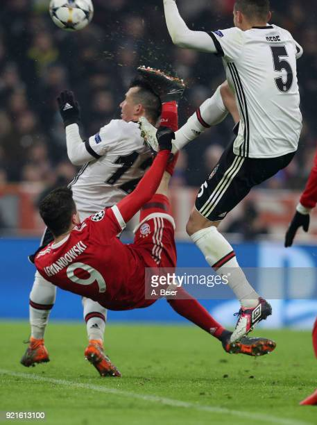 Robert Lewandowski of FC Bayern Muenchen hits Gary Medel of Besiktas JK with his foot during the UEFA Champions League Round of 16 first leg match...