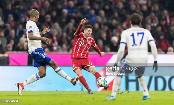 Robert Lewandowski of FC Bayern Muenchen is challenged by Naldo of FC Schalke 04 during the Bundesliga match between FC Bayern Muenchen and FC...