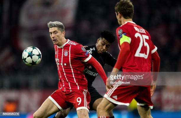 Robert Lewandowski of FC Bayern Muenchen is challenged by Presnel Kimpembe of Paris SaintGermain during the UEFA Champions League group B match...