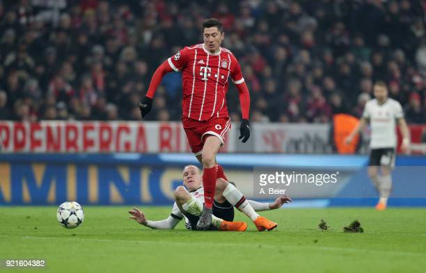Robert Lewandowski of FC Bayern Muenchen is fouled by Domagoj Vida of Besiktas during the UEFA Champions League Round of 16 first leg match between...
