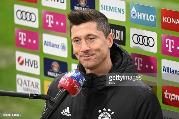 Robert Lewandowski of FC Bayern Muenchen is interviewed by Sky Sports after the Bundesliga match between FC Bayern Muenchen and VfB Stuttgart at...
