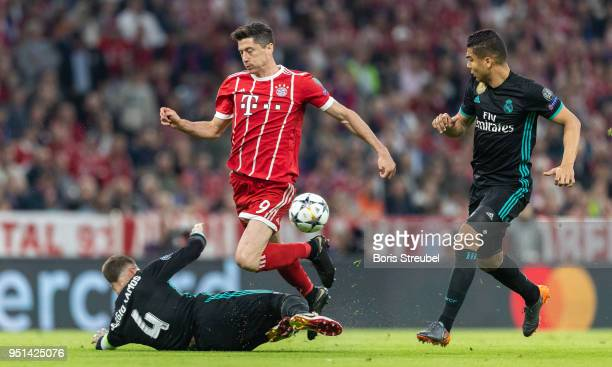 Robert Lewandowski of FC Bayern Muenchen is tackled by Sergio Ramos of Real Madrid during the UEFA Champions League Semi Final First Leg match...