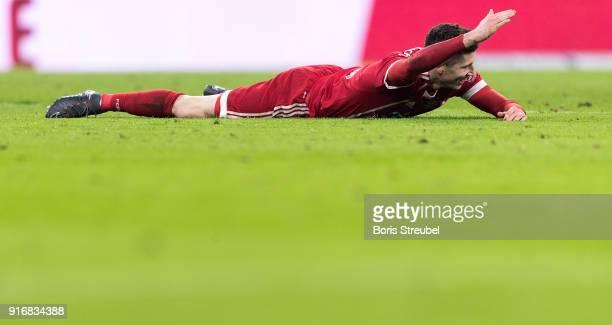 Robert Lewandowski of FC Bayern Muenchen lies on the pitch during the Bundesliga match between FC Bayern Muenchen and FC Schalke 04 at Allianz Arena...