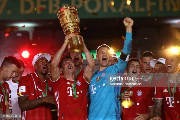 Robert Lewandowski of FC Bayern Muenchen lifts the DFB Cup winners trophy in celebration after the DFB Cup final match between Bayer 04 Leverkusen...
