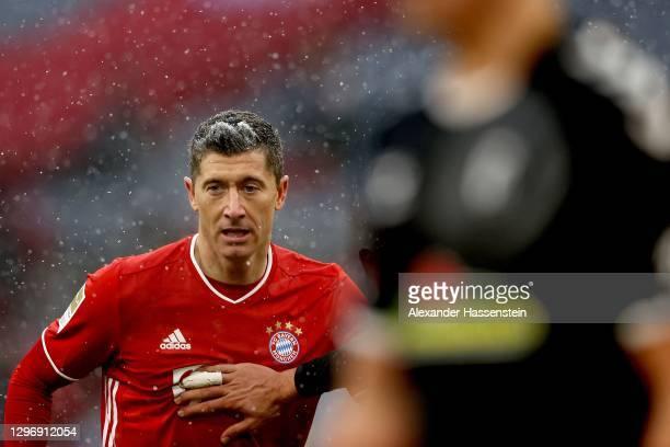 Robert Lewandowski of FC Bayern Muenchen looks on during the Bundesliga match between FC Bayern Muenchen and Sport-Club Freiburg at Allianz Arena on...