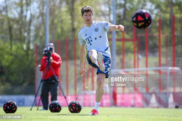 Robert Lewandowski of FC Bayern Muenchen plays the ball during a soccer dart challenge as part of a training session at Saebener Strasse training...
