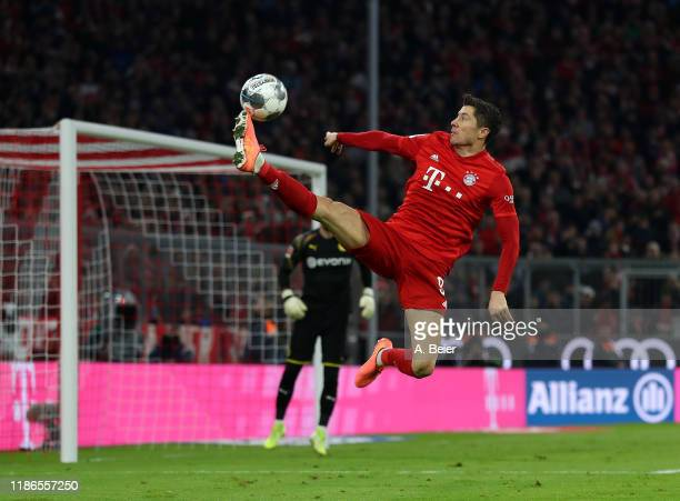 Robert Lewandowski of FC Bayern Muenchen plays the ball during the Bundesliga match between FC Bayern Muenchen and Borussia Dortmund at Allianz Arena...