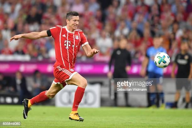 Robert Lewandowski of FC Bayern Muenchen plays the ball during the Bundesliga match between FC Bayern Muenchen and Bayer 04 Leverkusen at Allianz...