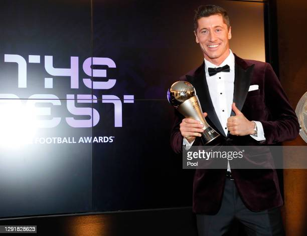Robert Lewandowski of FC Bayern Muenchen poses after winning the FIFA Men's Player 2020 trophy during the FIFA The BEST Awards ceremony on December...