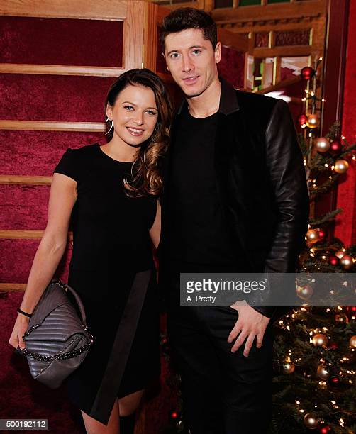 Robert Lewandowski of FC Bayern Muenchen poses for a photo with his wife Anna Stachurska during the FC Bayern Muenchen Christmas Party at Schuhbecks...