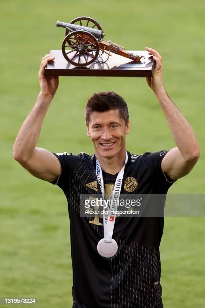 Robert Lewandowski of FC Bayern Muenchen raises the top goalscorer of the season award following the Bundesliga match between FC Bayern Muenchen and...