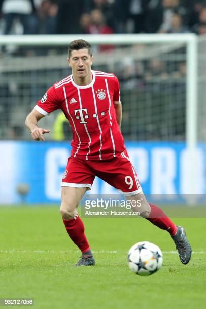 Robert Lewandowski of FC Bayern Muenchen runs with the ball during the UEFA Champions League Round of 16 Second Leg match Besiktas and Bayern...