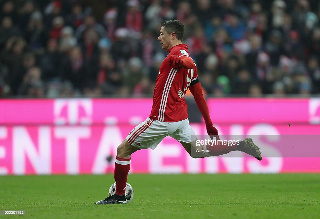 Robert Lewandowski of FC Bayern Muenchen scores a penalty goal against RB Leipzig during the Bundesliga match between Bayern Muenchen and RB Leipzig at Allianz Arena on December 21, 2016 in Munich, Germany.