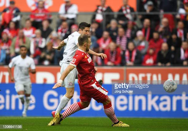 Robert Lewandowski of FC Bayern Muenchen scores his sides first goal during the Bundesliga match between 1. FC Koeln and FC Bayern Muenchen at...