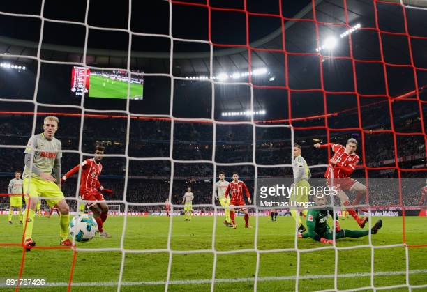 Robert Lewandowksi of FC Bayern Muenchen scores his team's first goal during the Bundesliga match between FC Bayern Muenchen and 1 FC Koeln at...