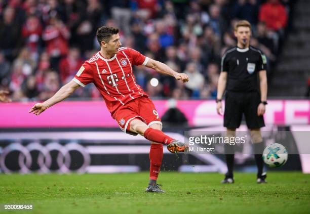 Robert Lewandowksi of FC Bayern Muenchen scores his team's sixth goal by penalty during the Bundesliga match between FC Bayern Muenchen and Hamburger...