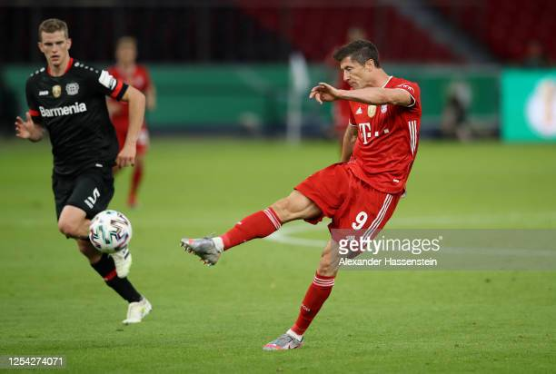 Robert Lewandowski of FC Bayern Muenchen scores his team's third goal during the DFB Cup final match between Bayer 04 Leverkusen and FC Bayern...