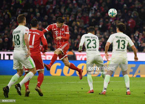 Robert Lewandowksi of FC Bayern Muenchen scores his team's third goal during the Bundesliga match between FC Bayern Muenchen and SV Werder Bremen at...