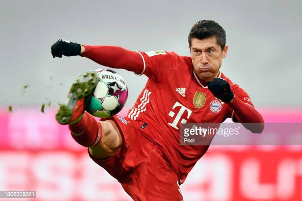 Robert Lewandowski of FC Bayern Muenchen scores their team's first goal during the Bundesliga match between FC Bayern Muenchen and DSC Arminia...