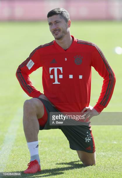 Robert Lewandowski of FC Bayern Muenchen smiles during a training session at the club's Saebener Strasse training ground on September 26, 2018 in...