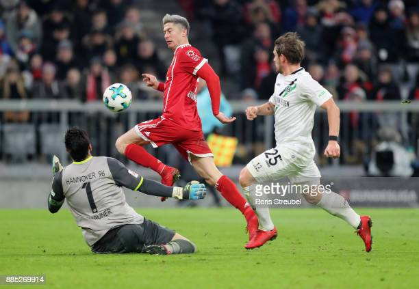 Robert Lewandowski of FC Bayern Muenchen tries to score against goalkeeper Philipp Tschauner of Hannover 96 during the Bundesliga match between FC...