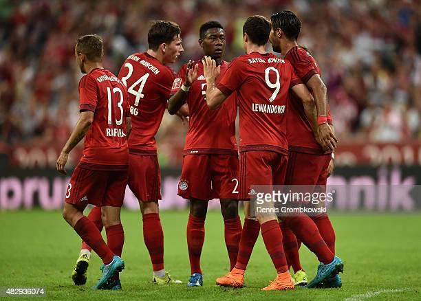 Robert Lewandowski of FC Bayern Munchen celebrates with team mates as he scores the third goal during the Audi Cup 2015 match between FC Bayern...