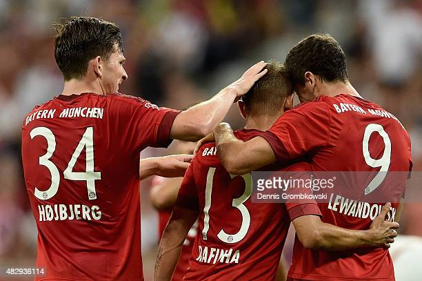Robert Lewandowski of FC Bayern Munchen celebrates with team mates as he scores the third goal during the Audi Cup 2015 match between FC Bayern...