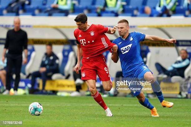 Robert Lewandowski of FC Bayern Munich battles for possession with Pavel Kaderabek of TSG 1899 Hoffenheim during the Bundesliga match between TSG...