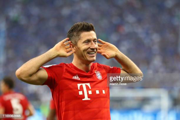 Robert Lewandowski of FC Bayern Munich celebrates after scoring his team's second goal during the Bundesliga match between FC Schalke 04 and FC...