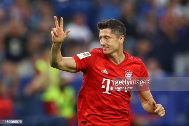 Robert Lewandowski of FC Bayern Munich celebrates after scoring his team's third goal during the Bundesliga match between FC Schalke 04 and FC Bayern...