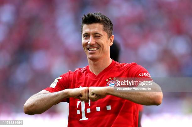 Robert Lewandowski of FC Bayern Munich celebrates after scoring his team's fifth goal during the Bundesliga match between FC Bayern Muenchen and 1...