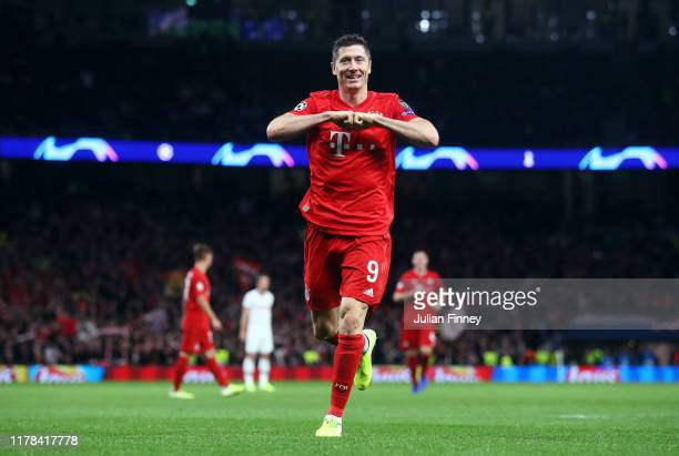 Robert Lewandowski of FC Bayern Munich celebrates after scoring his team's sixth goal during the UEFA Champions League group B match between...