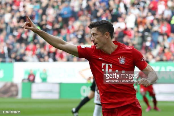 Robert Lewandowski of FC Bayern Munich celebrates after scoring his team's first goal during the Bundesliga match between FC Augsburg and FC Bayern...